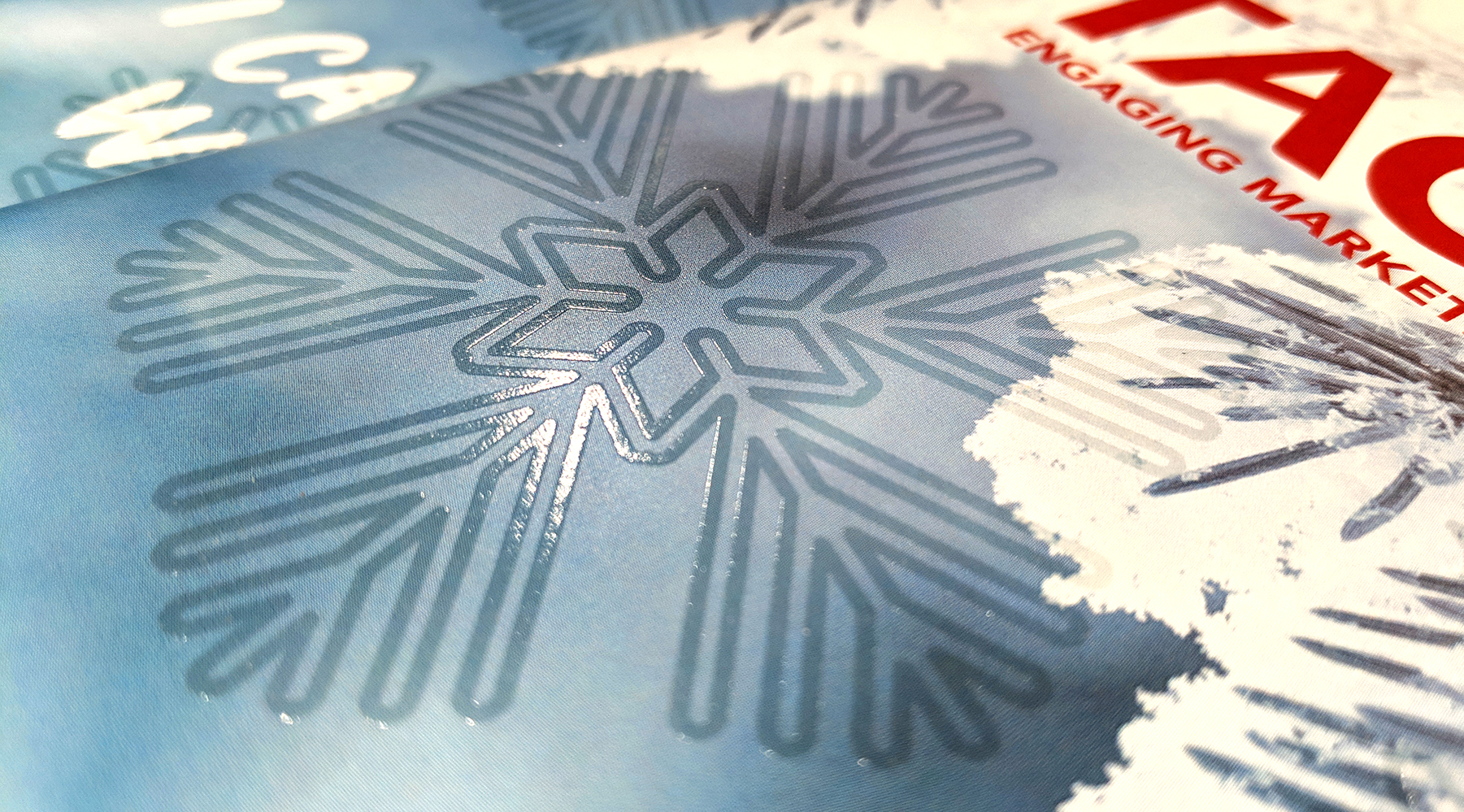 Raised print applied to snowflake on cover of Tactics Magazine